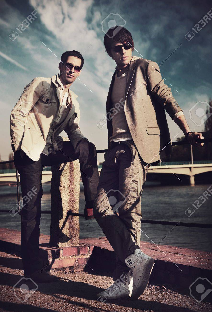 Two handsome friends posing on a city promenade Stock Photo - 8943222