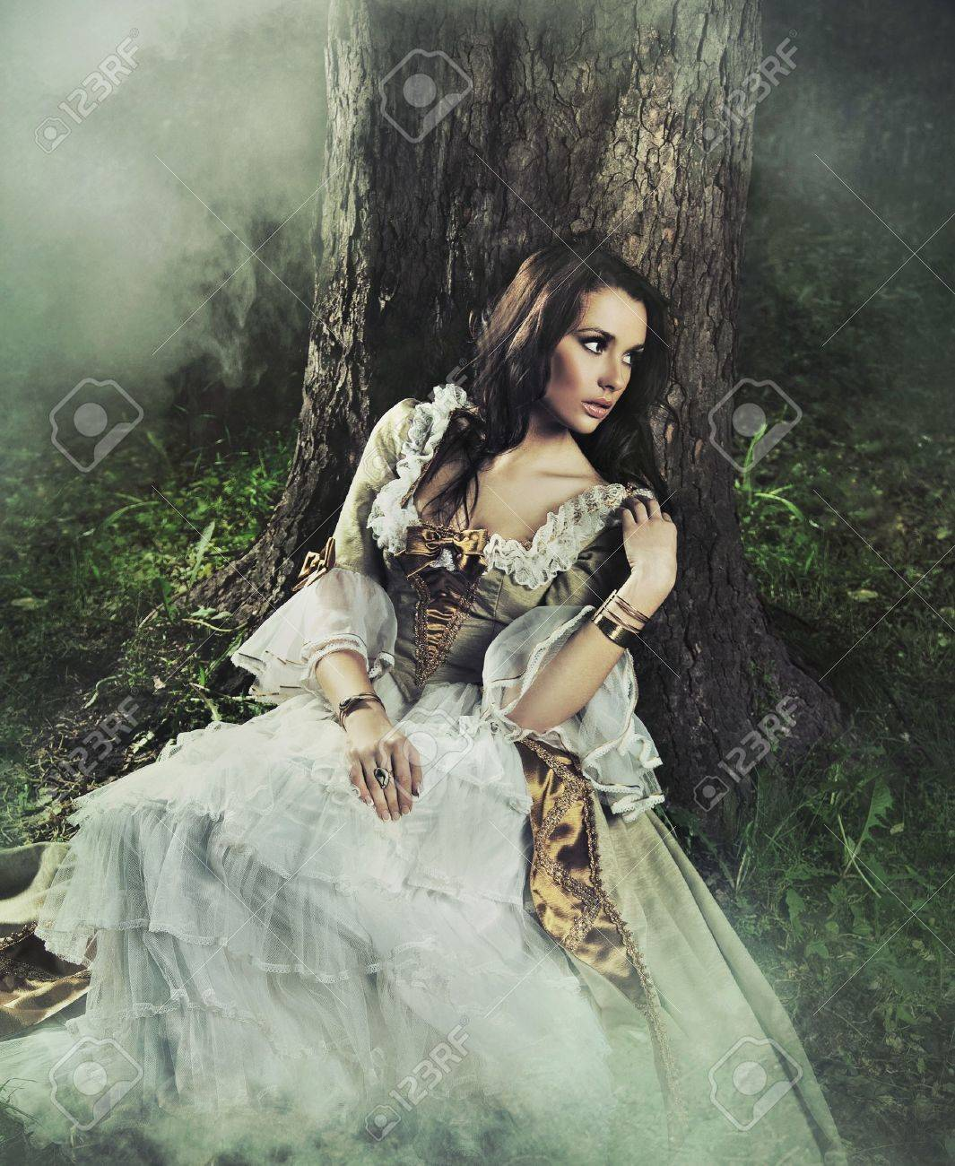 Young lady in a mysterious forest Stock Photo - 8942863