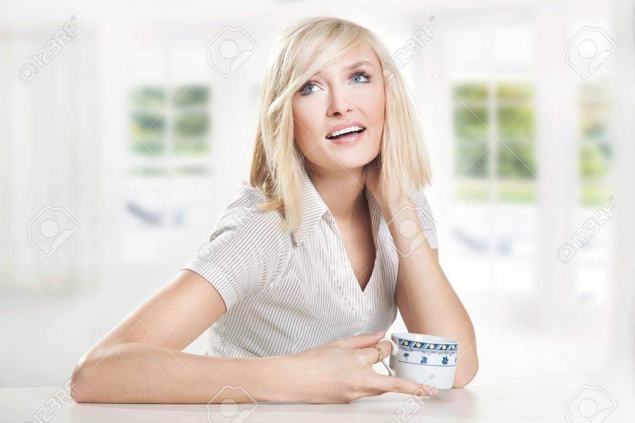 Happy young woman drinking coffee Stock Photo - 9065136