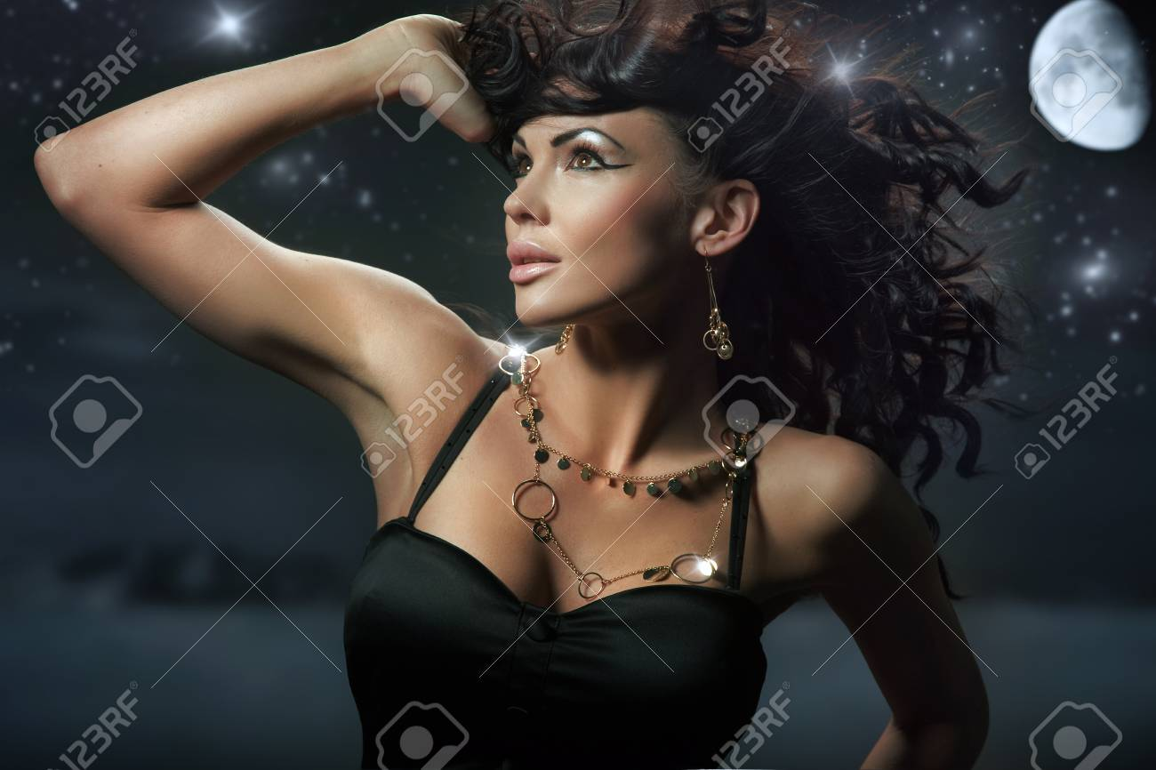 Fashionable brunette over starry night background Stock Photo - 9065202