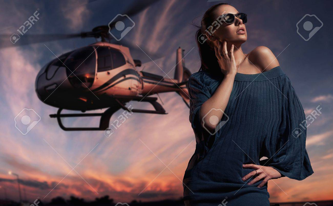 fashionable lady wearing sunglasses with helicopter in the background Stock Photo - 9067535