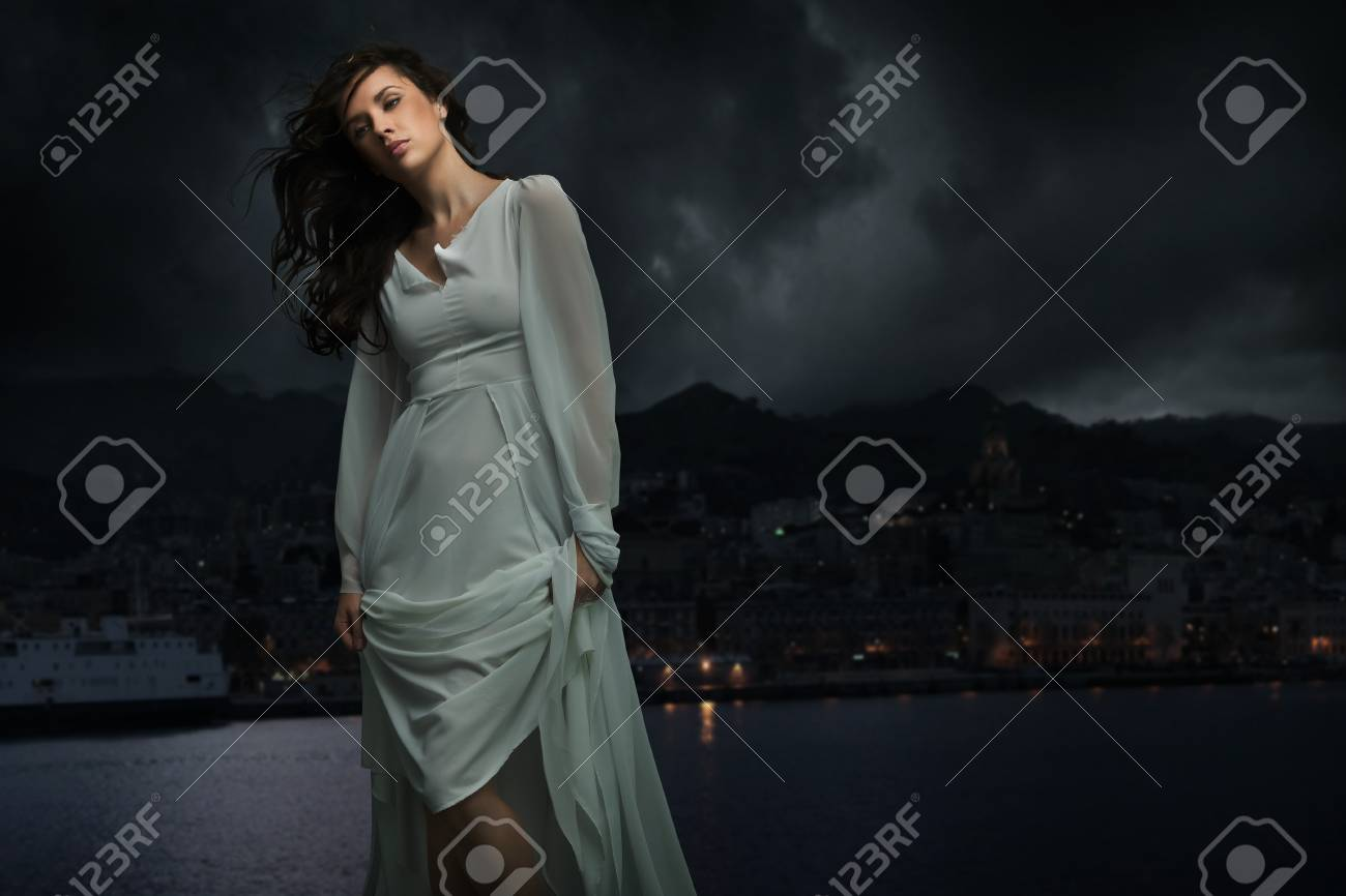 Cute brunette over city background Stock Photo - 9065502