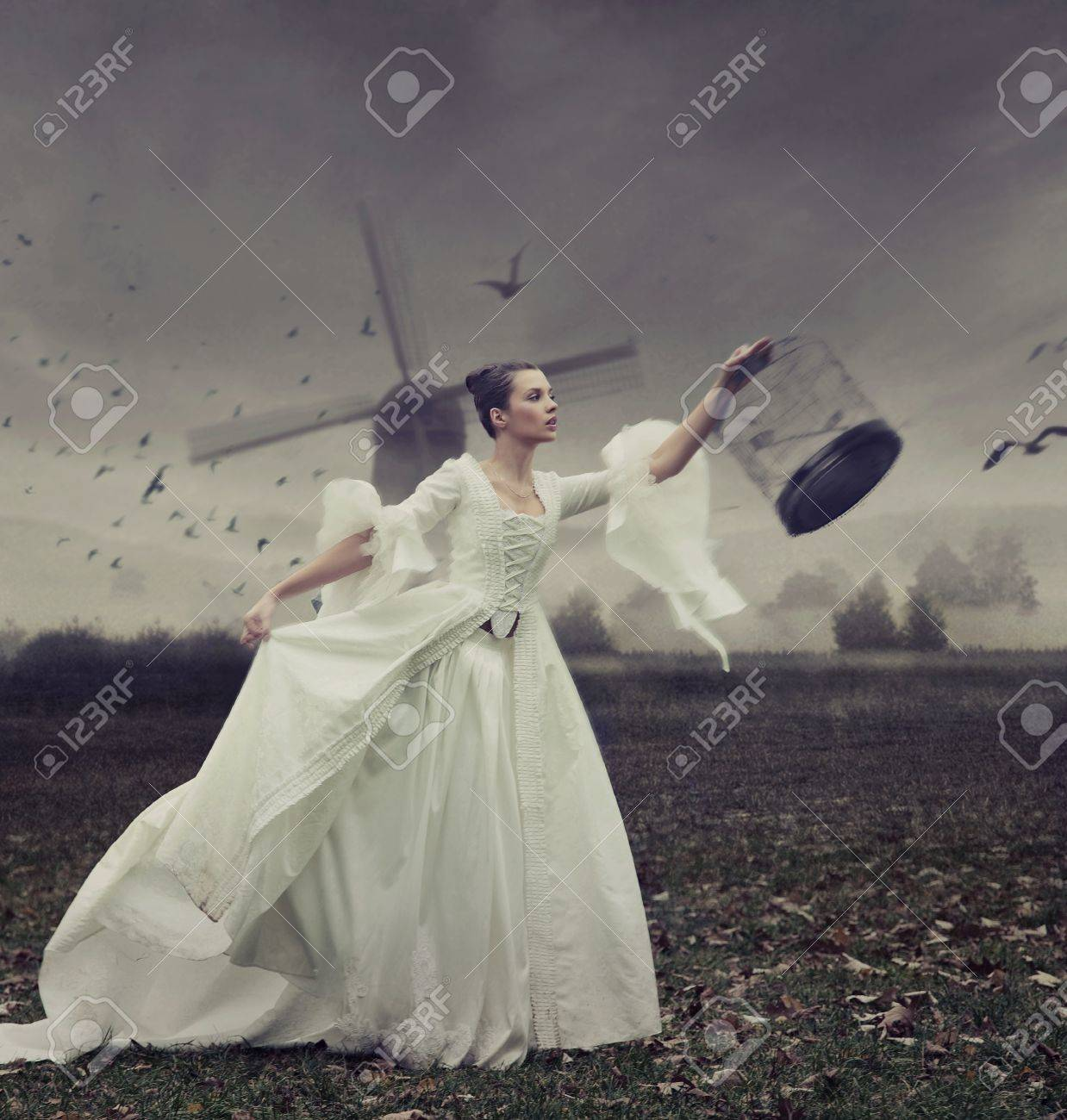Pretty young woman with cage Stock Photo - 9070960