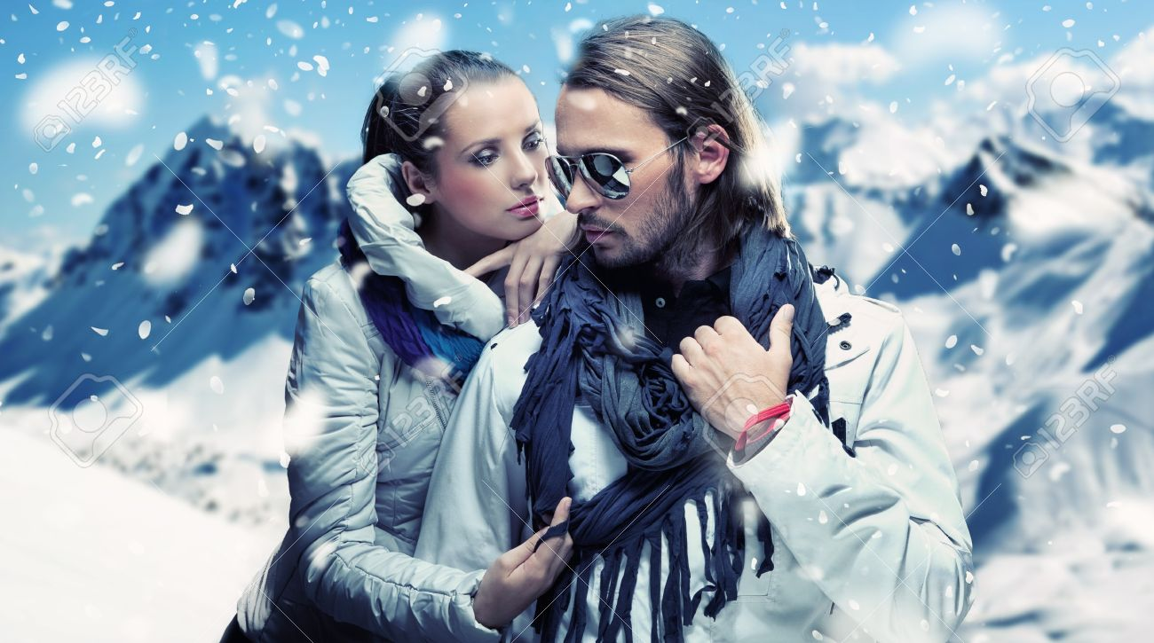 Handsome couple having fun on winter holidays Stock Photo - 9078225