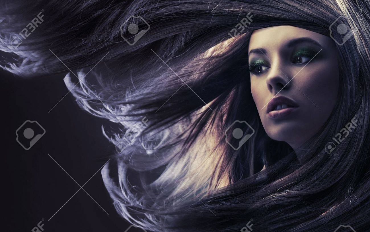 Beautiful lady with long brown hair, at moonlight Stock Photo - 9188751