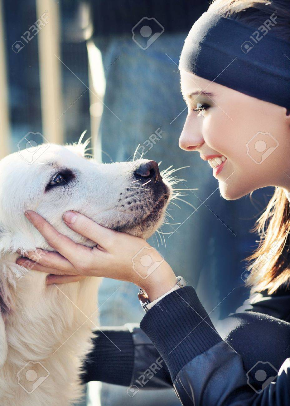 young woman with dog Stock Photo - 9189147