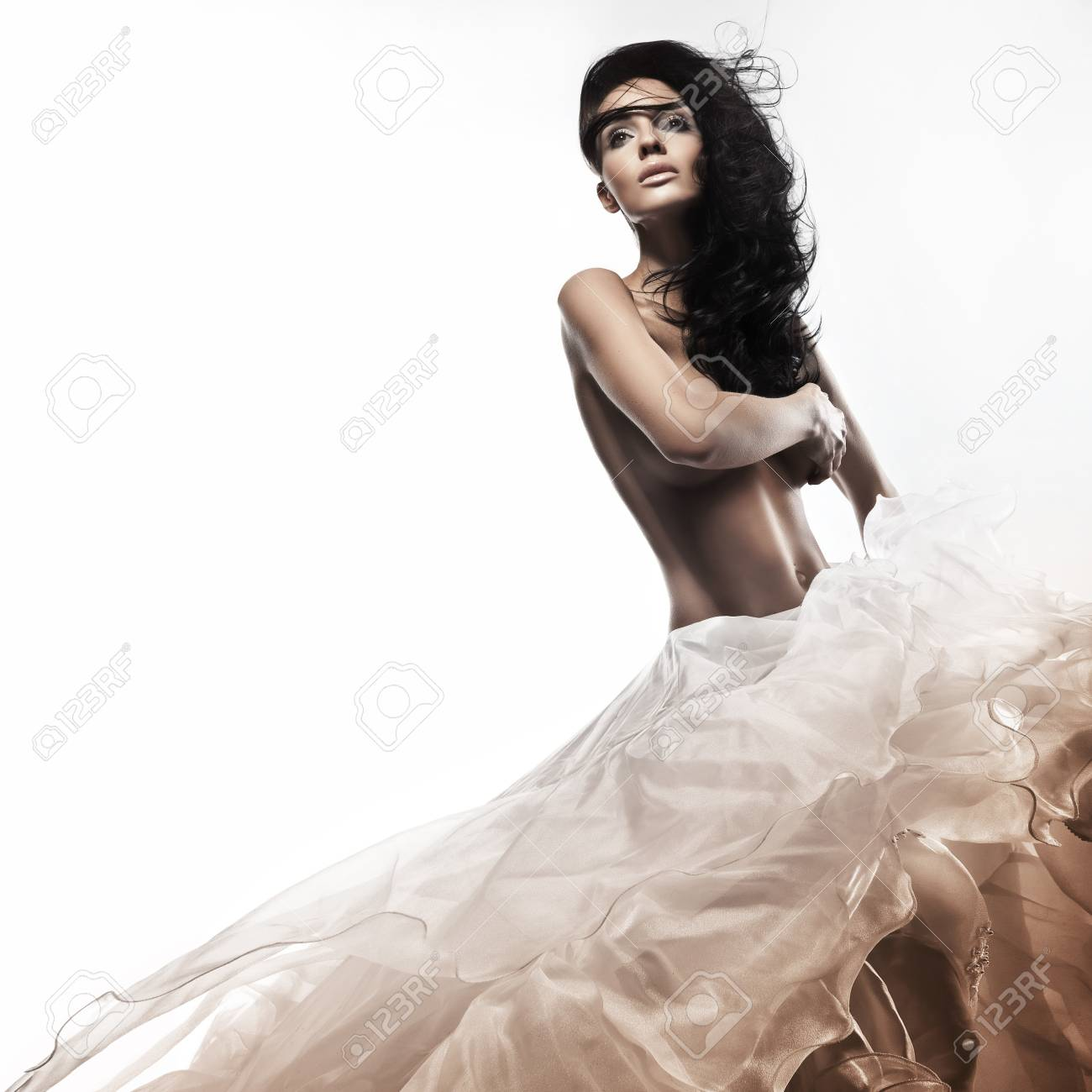 Beautiful young brunette in a romantic pose Stock Photo - 9189270