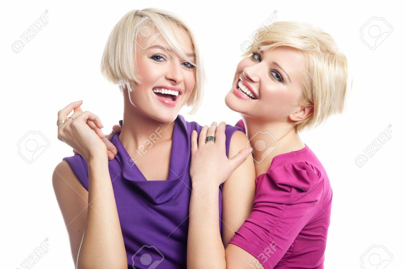 Attractive blonde friens smiling Stock Photo - 9235086
