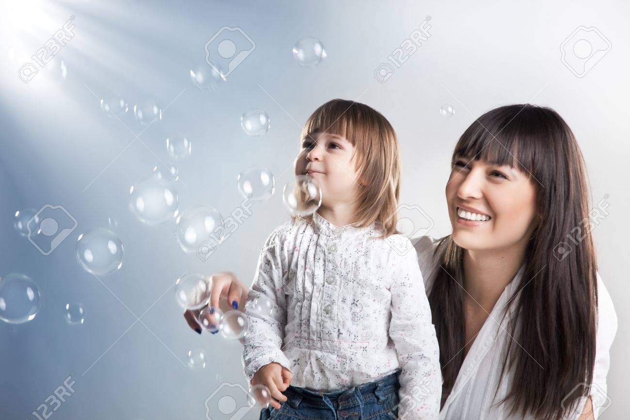 Smiling woman and her daughter Stock Photo - 9233962