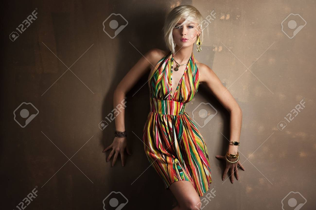 Beautiful young blonde girl posing in colorful dress Stock Photo - 9336852