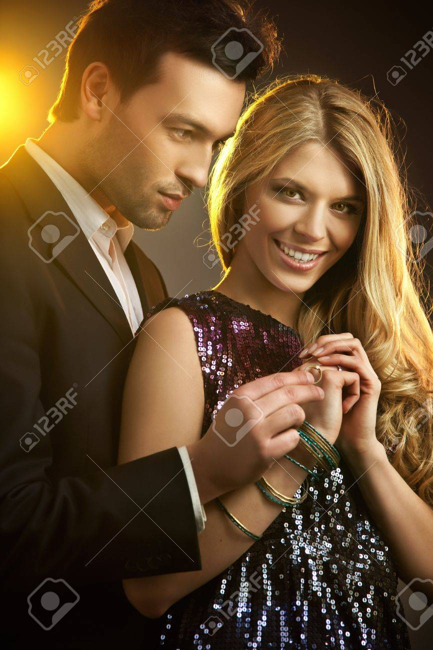 Happy young man gifting a ring to a beautiful young woman Standard-Bild - 9469067