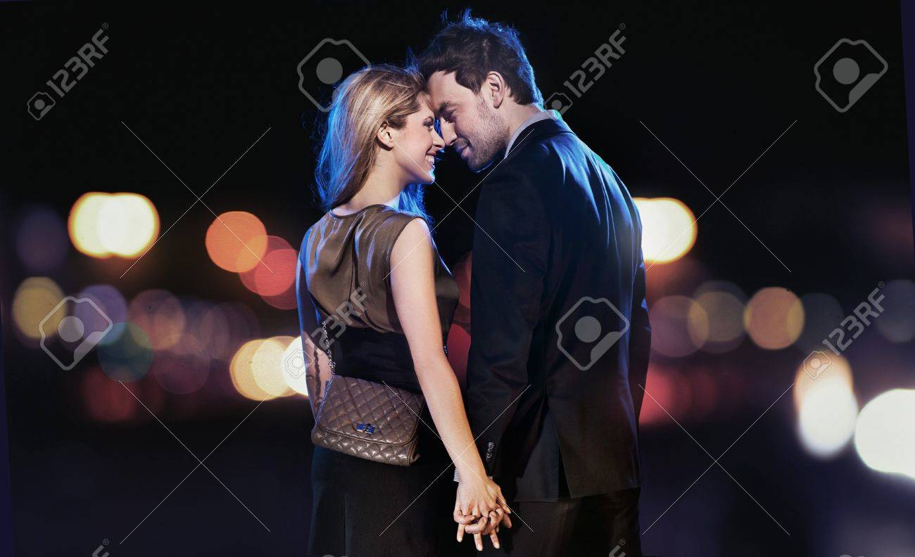 Conceptual portrait of a young couple in elegant evening dresses Stock Photo - 9467995