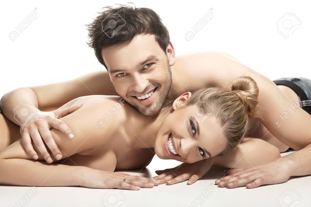 Beautiful young couple lying on the bed Stock Photo - 9469068