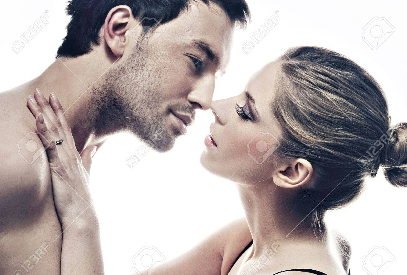 portrait of handsome couple gently kissing - 9467962