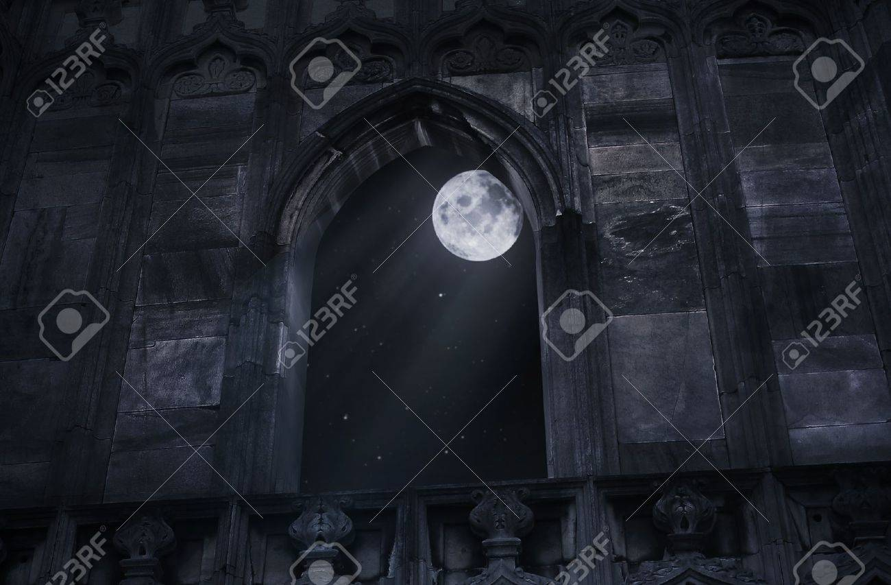 Full moon seen through the window of the old castle Stock Photo - 9343274