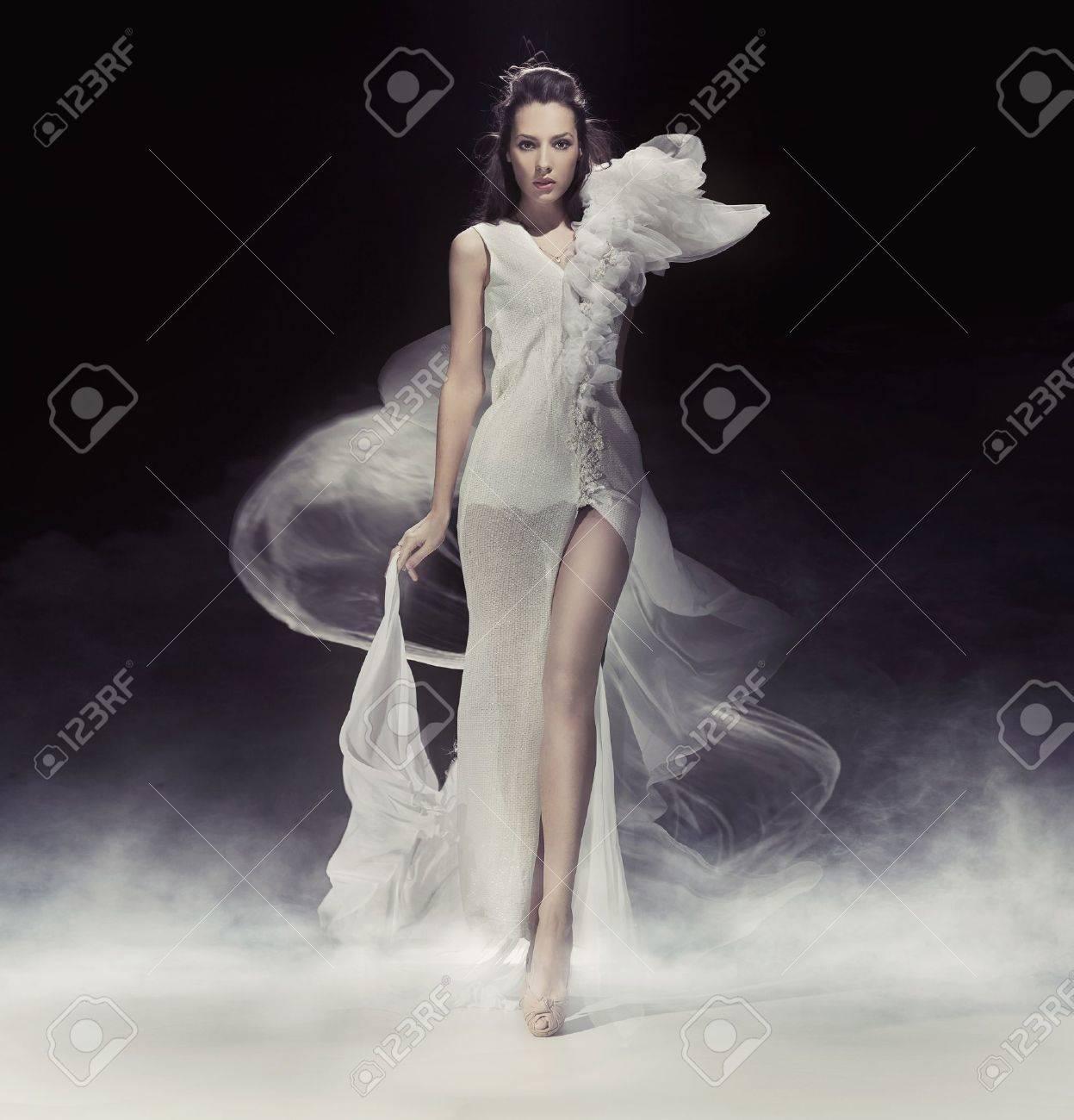 Beautiful brunette lady in white dress Stock Photo - 9343453