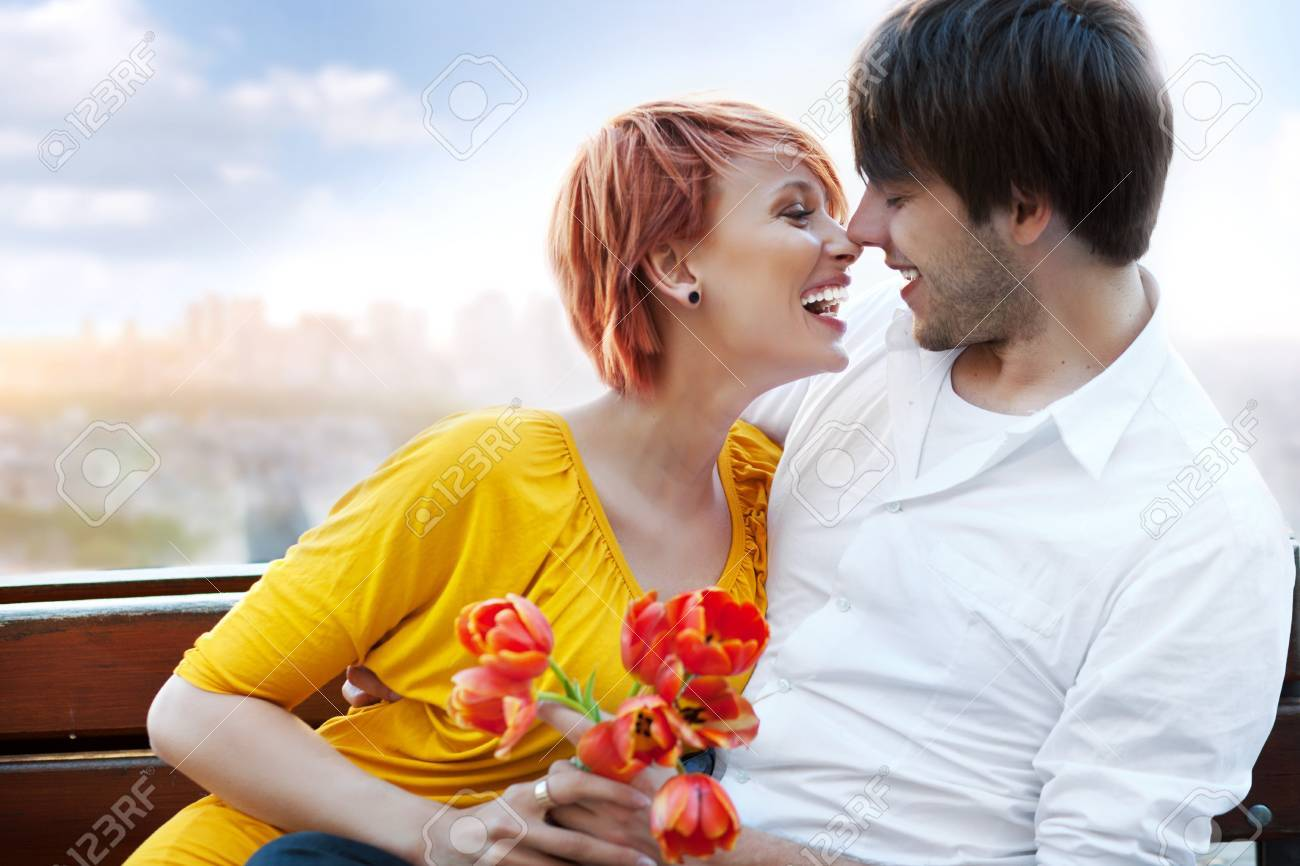 Young happy smiling attractive couple together outdoors Stock Photo - 9941990