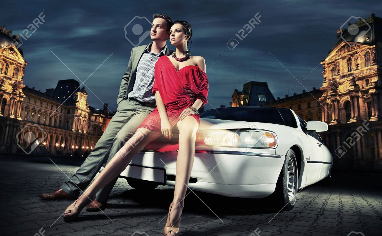 Sexy young couple in front of a limousine Stock Photo - 9941751