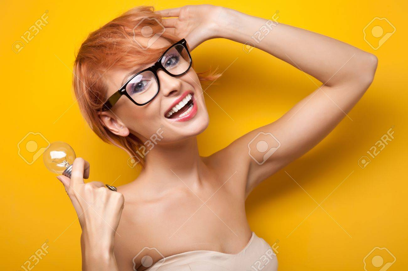 Smiling woman with light bulb Stock Photo - 9941325