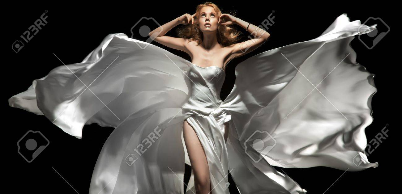 Gorgeous female model wearing white dress Stock Photo - 9965214
