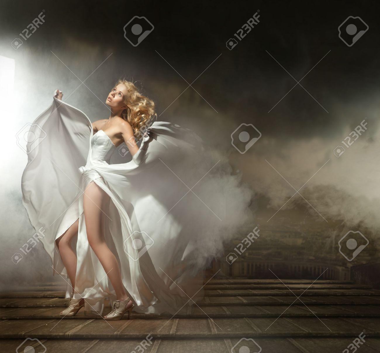 Art photo of a sexy woman in beautiful dress Stock Photo - 9965363