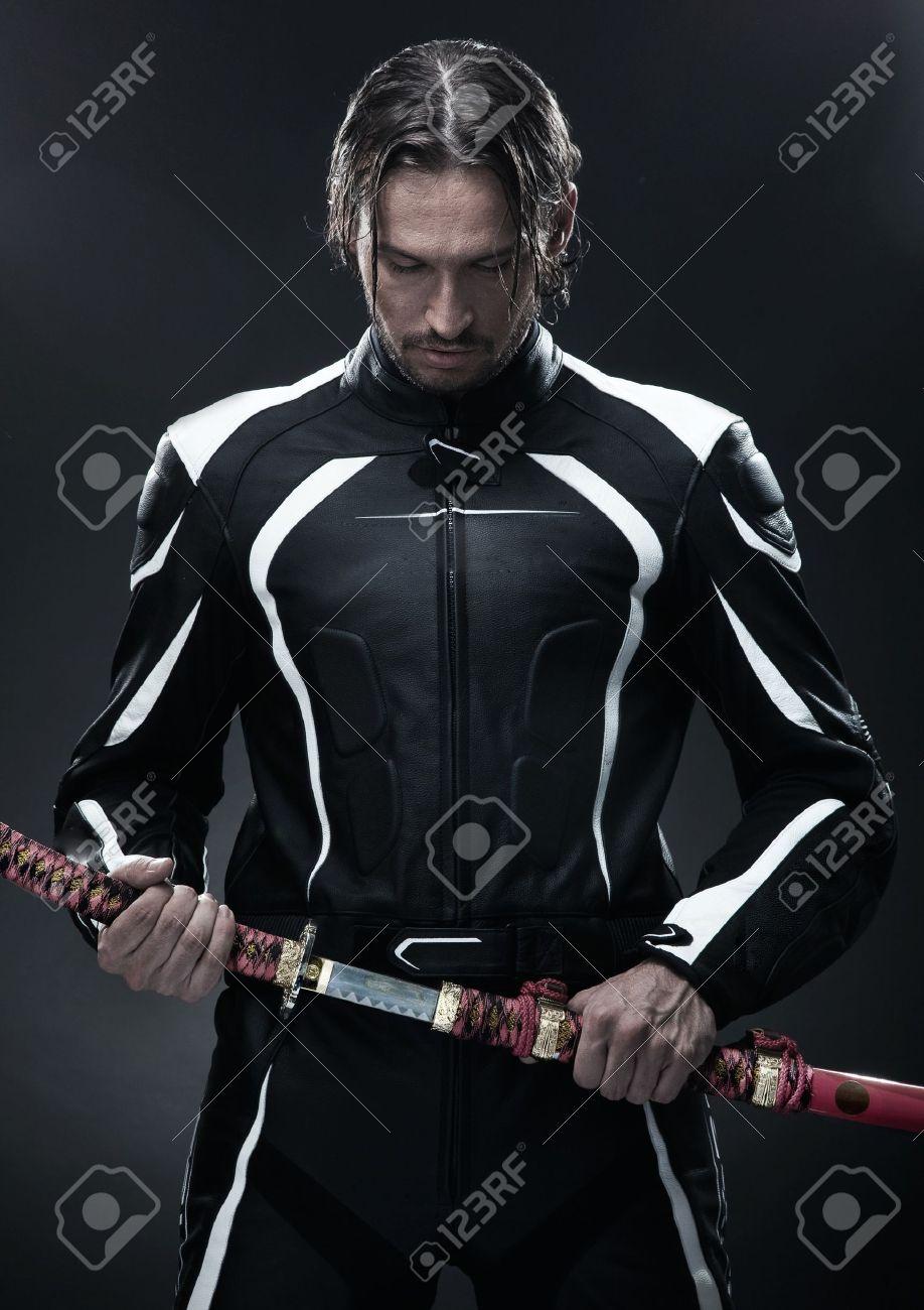 Handsome man holding a samurai sword Stock Photo - 10056611