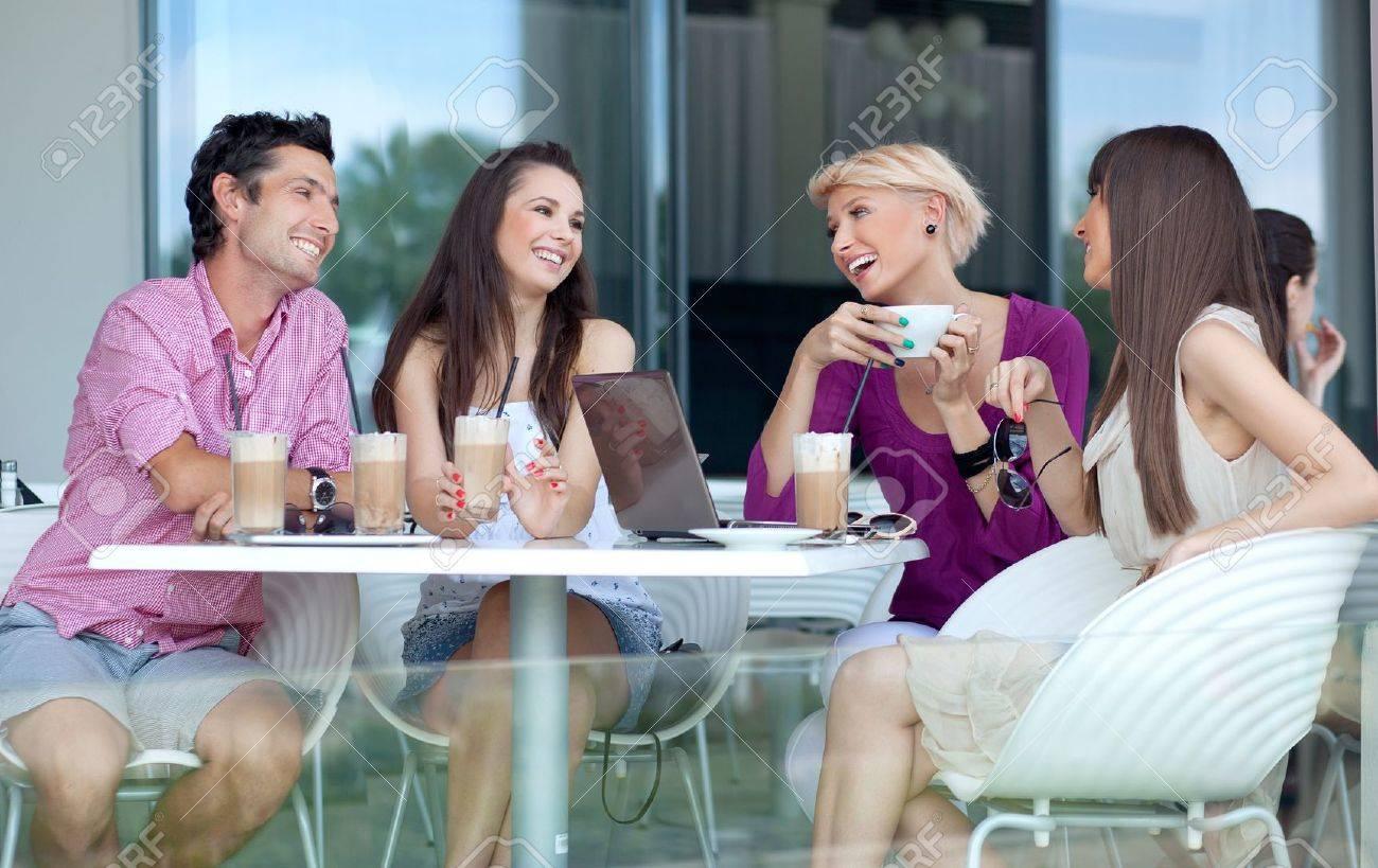 Young people enjoying coffee break Stock Photo - 10428244