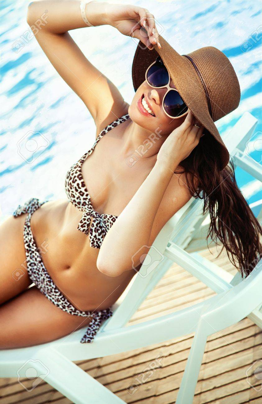 Sexy young lady at swimming pool Stock Photo - 11940379