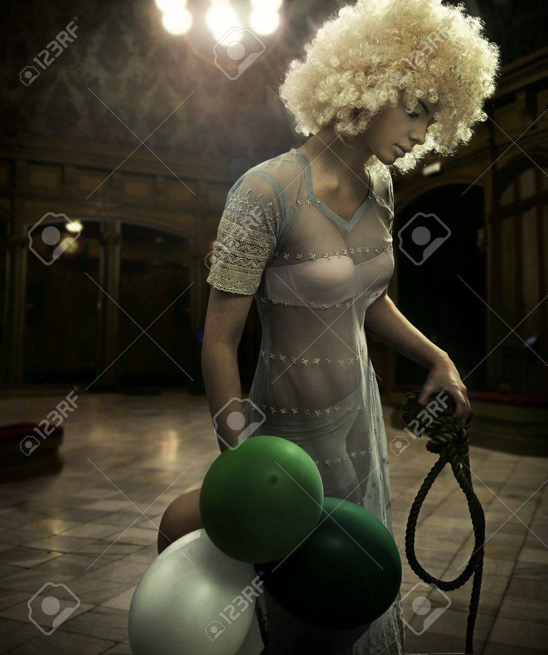 Mysterious scene of a blonde beauty in a dark interior Stock Photo - 12526248