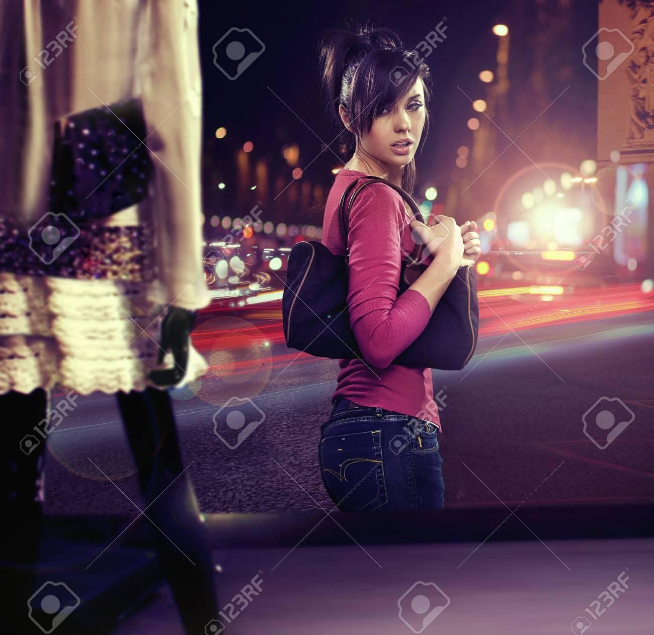 Walking woman looking at shop window Stock Photo - 13686664