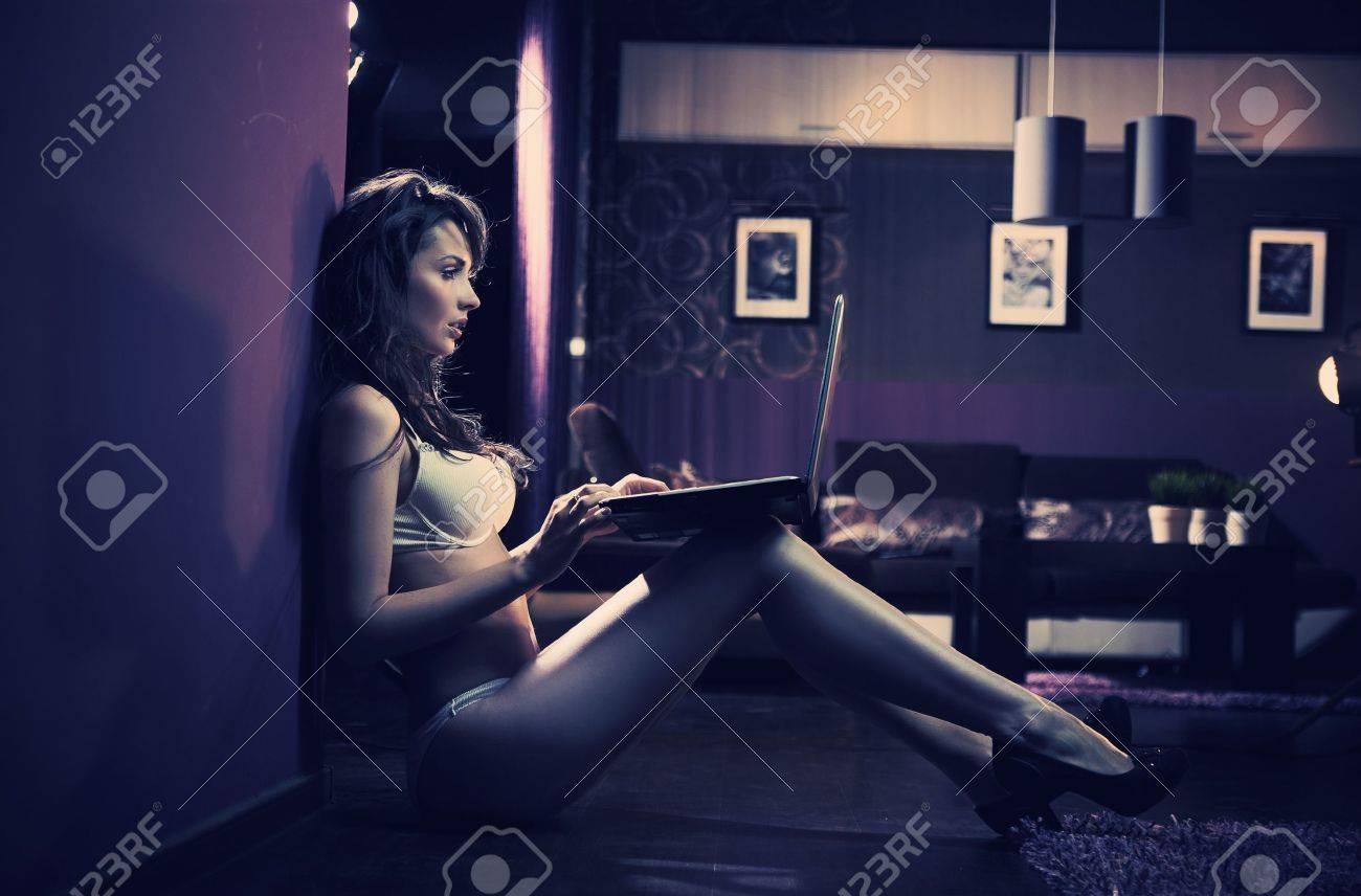 Sexy woman browsing internet late night Stock Photo - 13705428