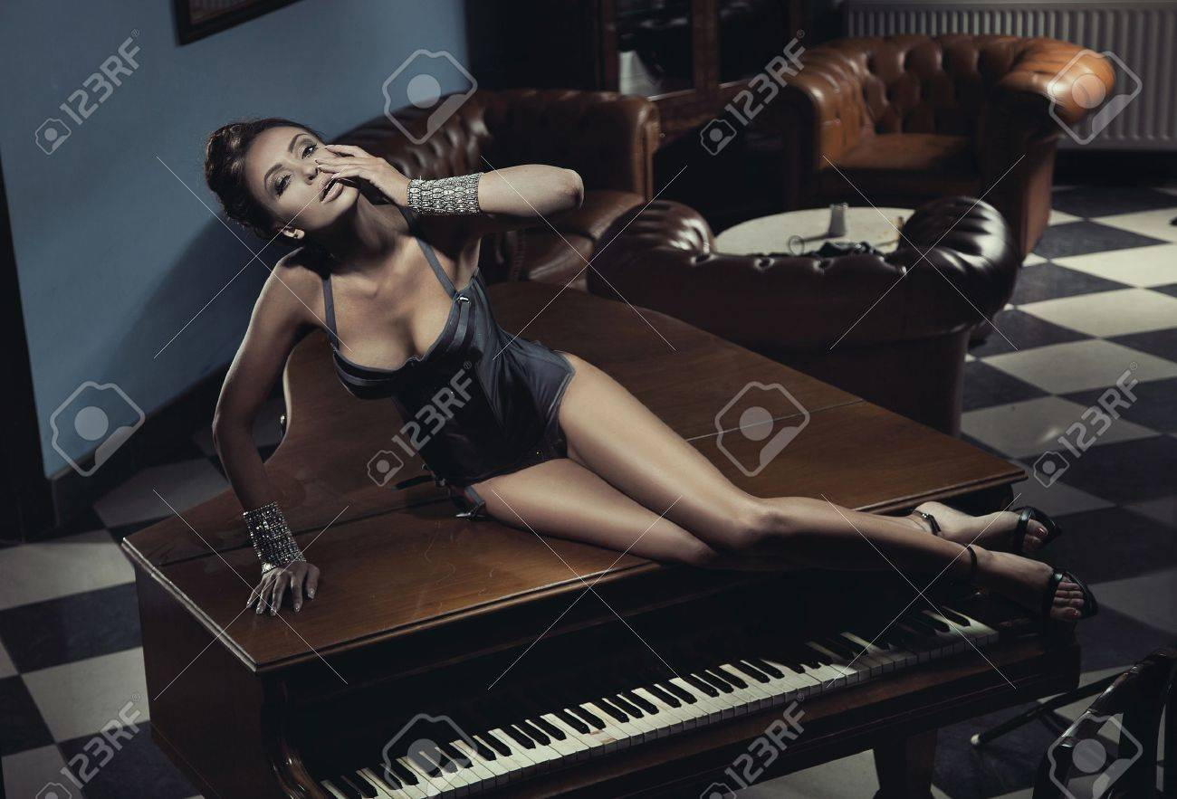 Sexy actress laying on a piano Stock Photo - 14484759