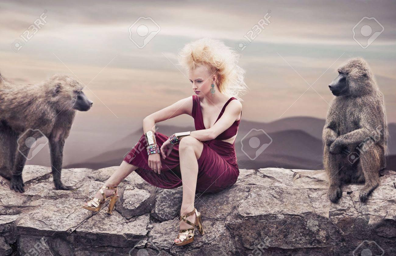 Blond beauty posing with monkeys Stock Photo - 15832286
