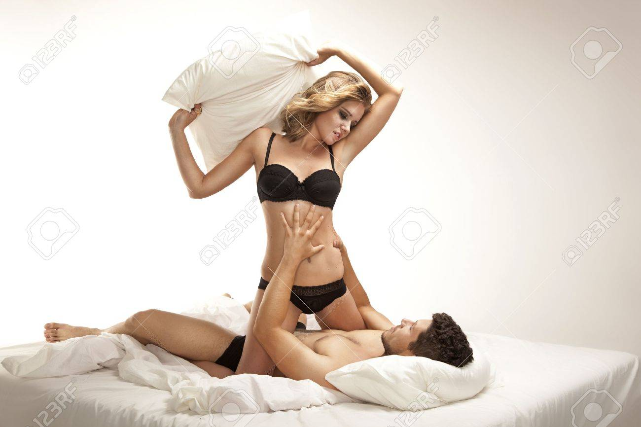 Young couple having fun in a bed Stock Photo - 15864460