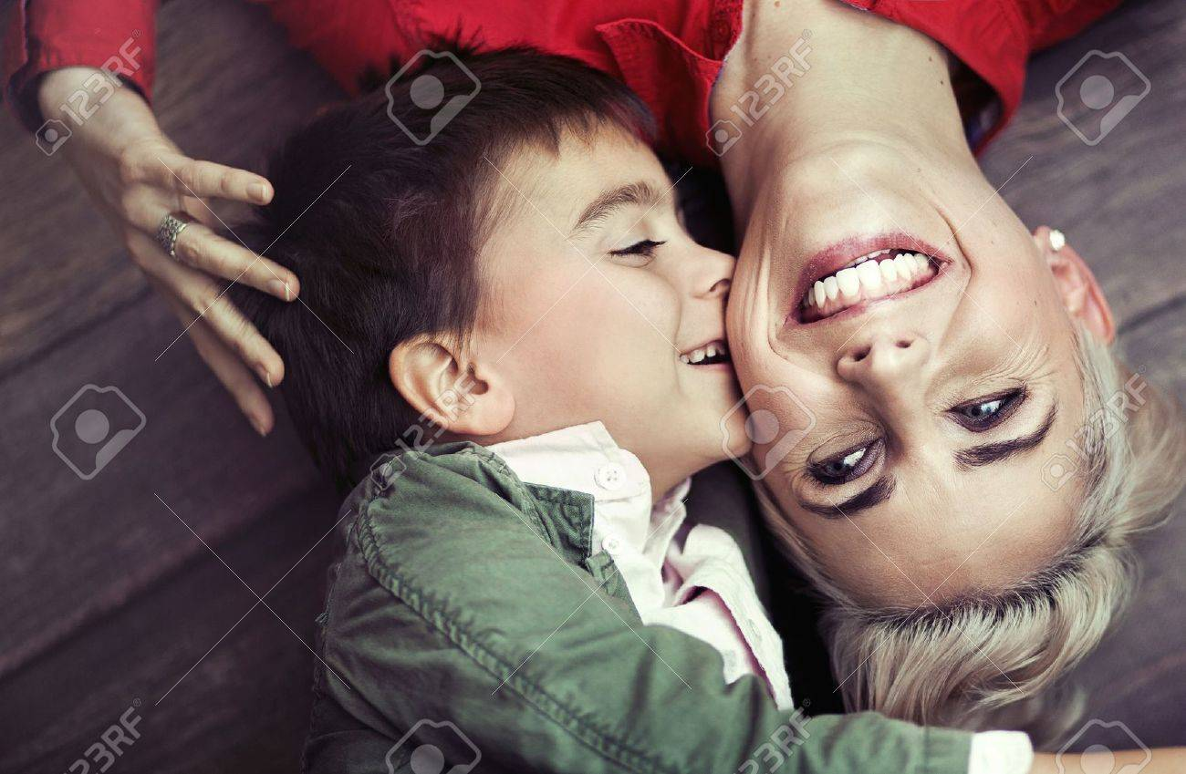 Young boy kissing his smiling mom Stock Photo - 17014703
