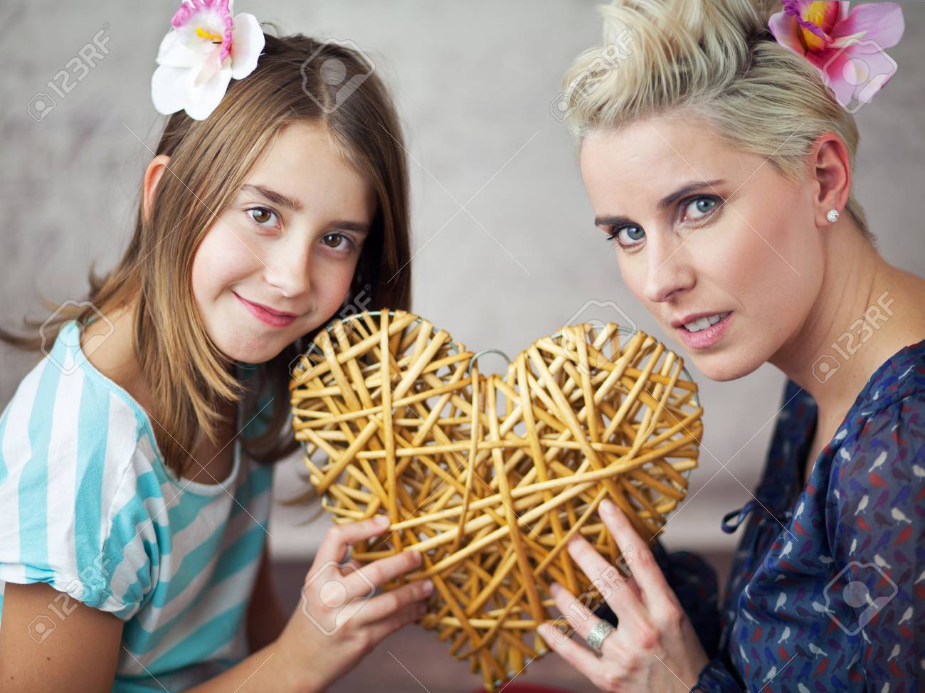 Mother and young daughter keeping toy heart Stock Photo - 17014694