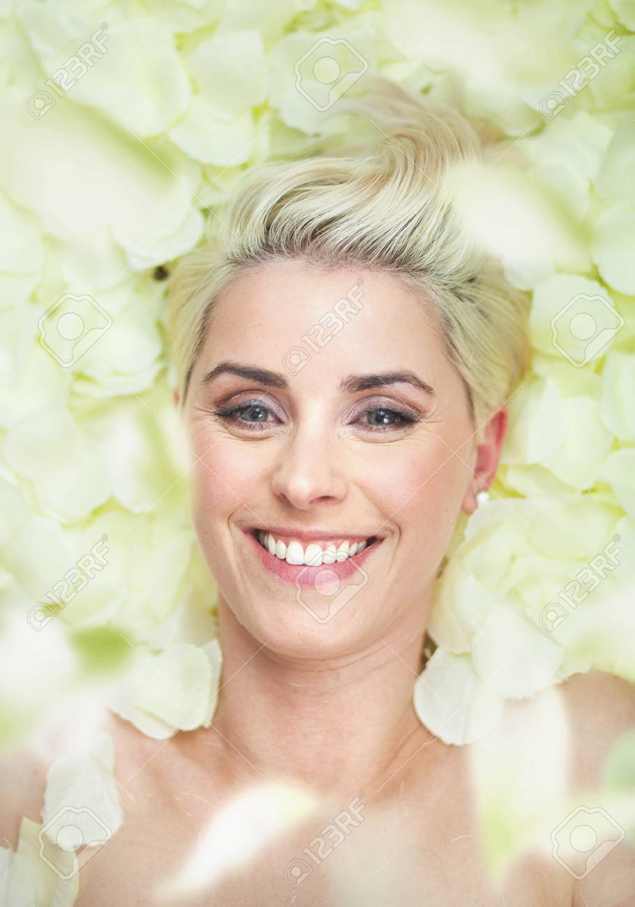 Attractive short-hair woman among rose petals Stock Photo - 17049453