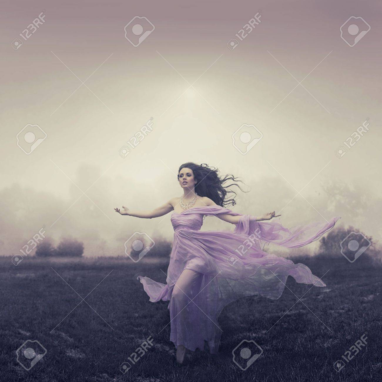 Portrait of beautiful woman running over the field Stock Photo - 17626030