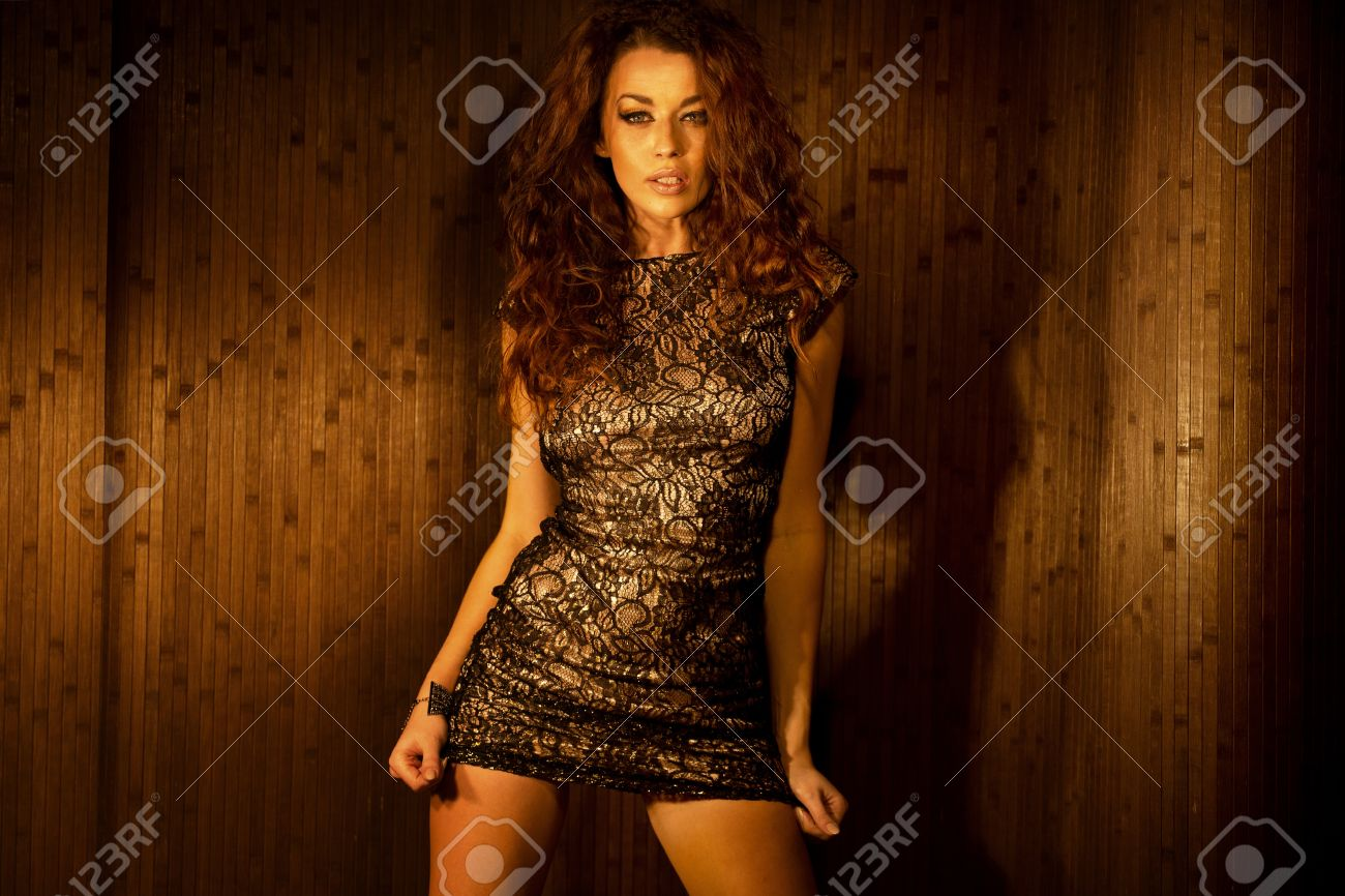 Alluring brunette young woman wearing sensual clothes Stock Photo - 18393963