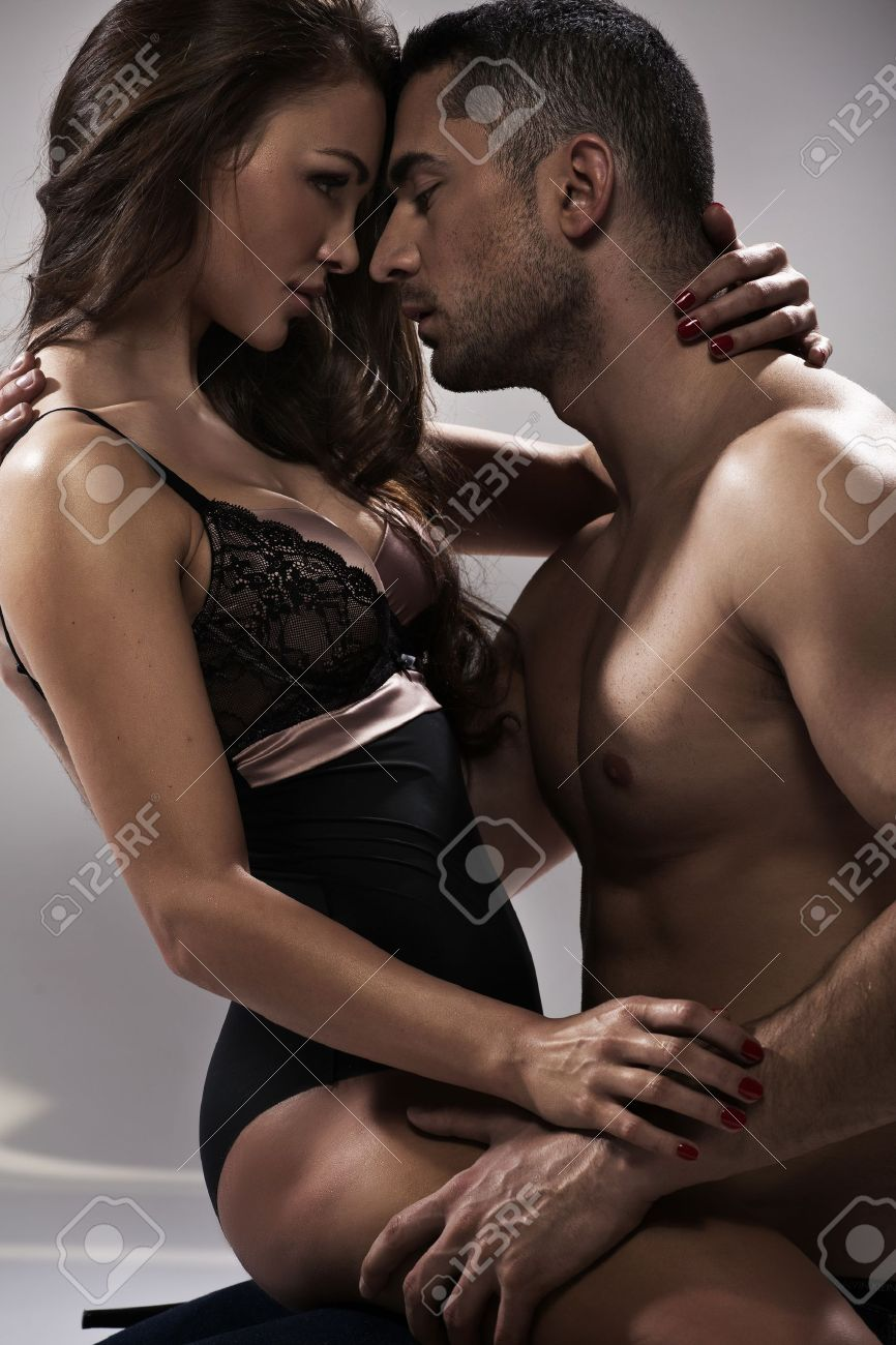 Sensual pose of an attractive young couple Stock Photo - 18418927