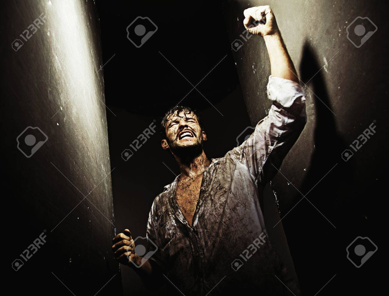 Exhausted victorious guy after tough survival Stock Photo - 19566686