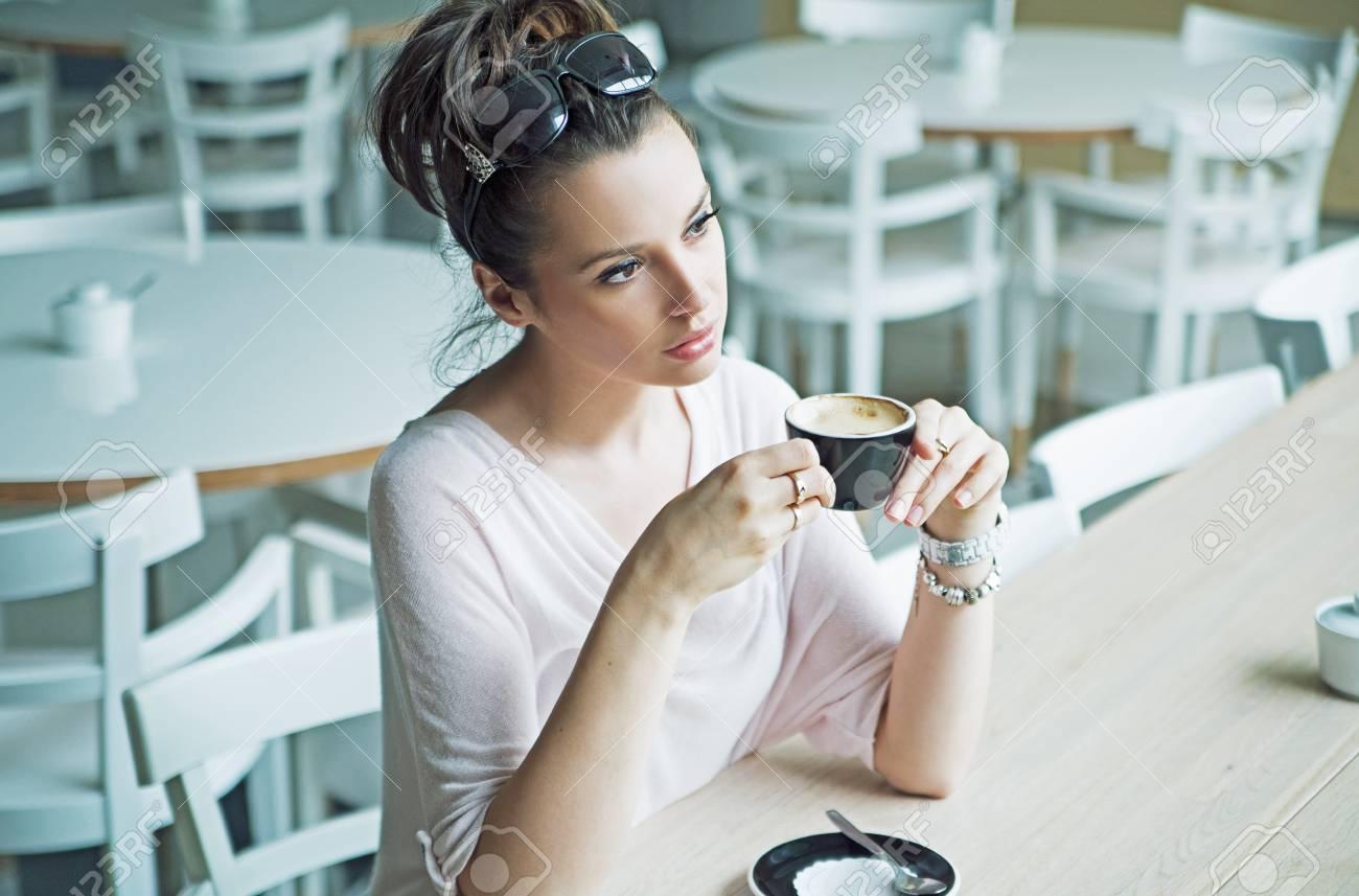 Thoughtfull cute woman at the coffee break Stock Photo - 21553321