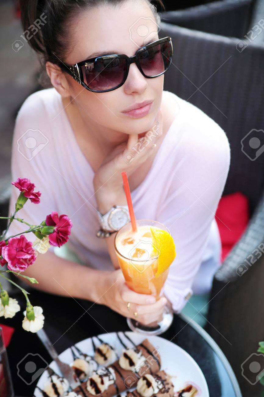 Calm brunette woman in the cafe Stock Photo - 21553376