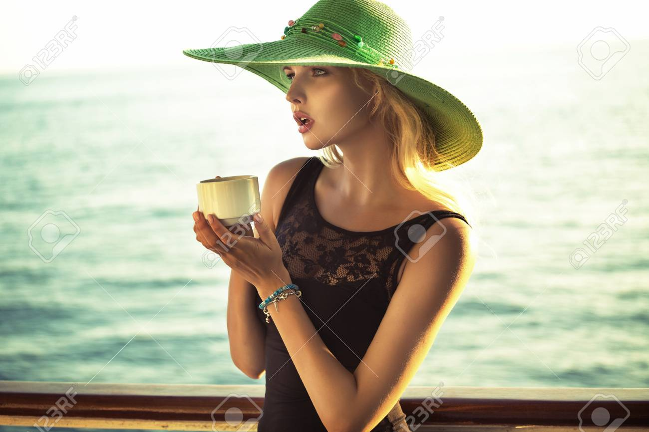Fashion photo of smart lady holding a cup of coffee Stock Photo - 22306230