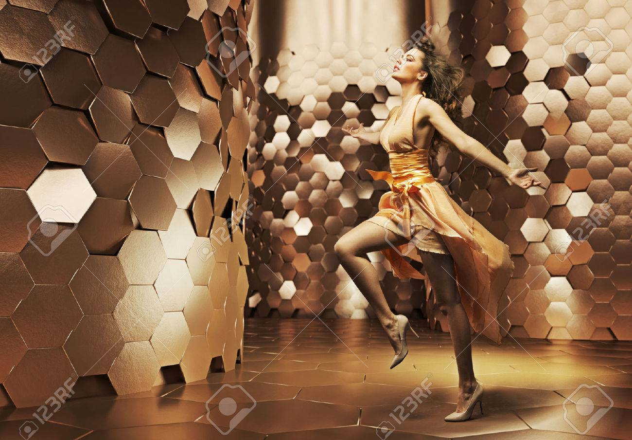 Dancing young lady wearing fabulous dress Stock Photo - 26669142