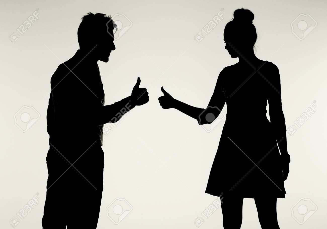 Young and peaceful couple showing OK sign Stock Photo - 29748446