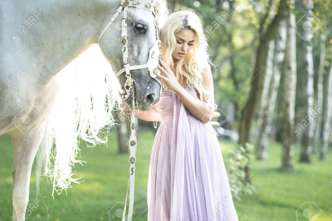 Blond Cute Woman With A White Horse Stock Photo Picture And Royalty Free Image Image 33049561