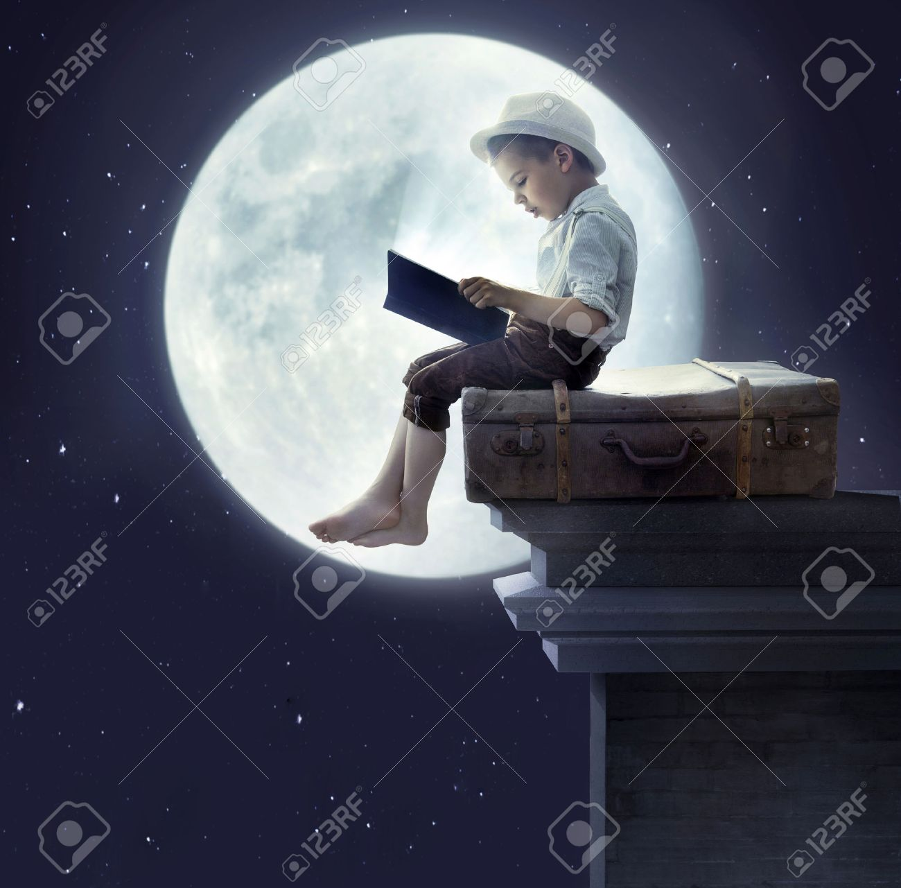 Kids at night with moon royalty free stock photography image - Portrait Of A Little Boy Reading A Fairy Tale
