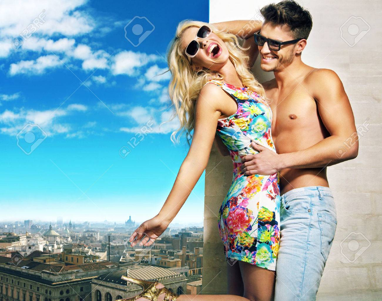Stock Photo   Young couple hugging over the city panorama. Young Couple Hugging Over The City Panorama Stock Photo  Picture