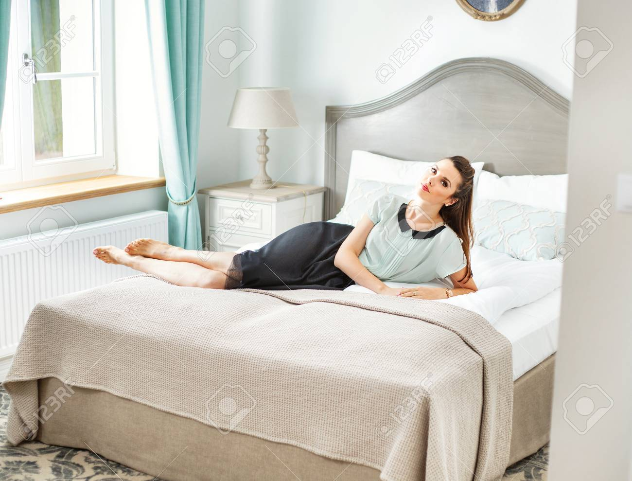 Stylish Woman Lying In The Fancy Bedroom Stock Photo Picture And Royalty Free Image Image 49748887